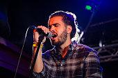 Man singing on microphone in nightclub