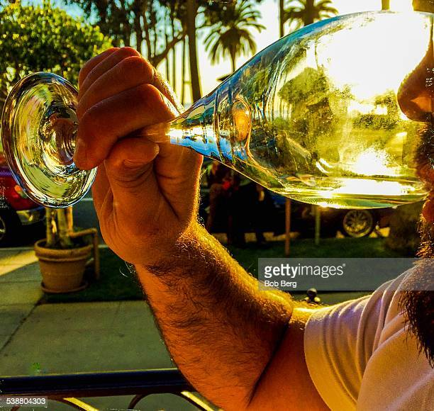 Santa Monica Ca February 11 2015 A man sips his glass of Napa valley Luna Pinot Grigio