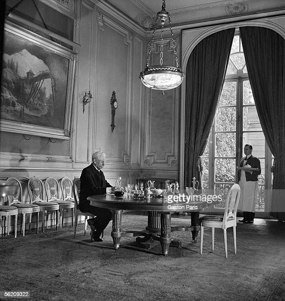 Man sit down at a table France about 1935
