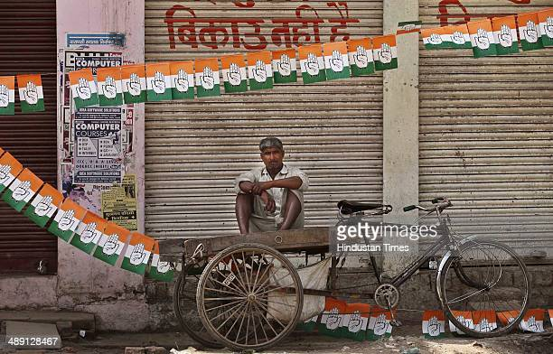 A man sit on a logistic rickshaw during a road show of Congress Vice President Rahul Gandhi in support for Ajay Rai Lok Sabha election candidate from...