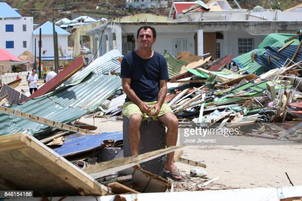 A man sits alone in damage Grand Case Saint Martin days after this Caribbean island sustained extensive damage after the passing of Hurricane Irma on...