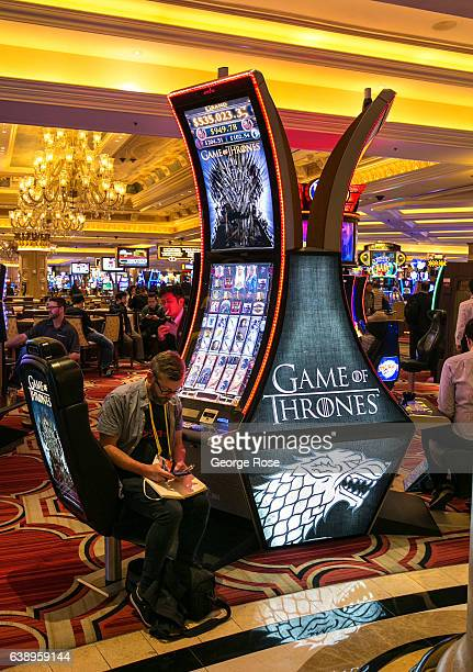 A man sits at a Venetian Hotel Casino 'Game of Thrones' slot machine on January 3 2017 in Las Vegas Nevada Tourism in America's 'Sin City' has within...