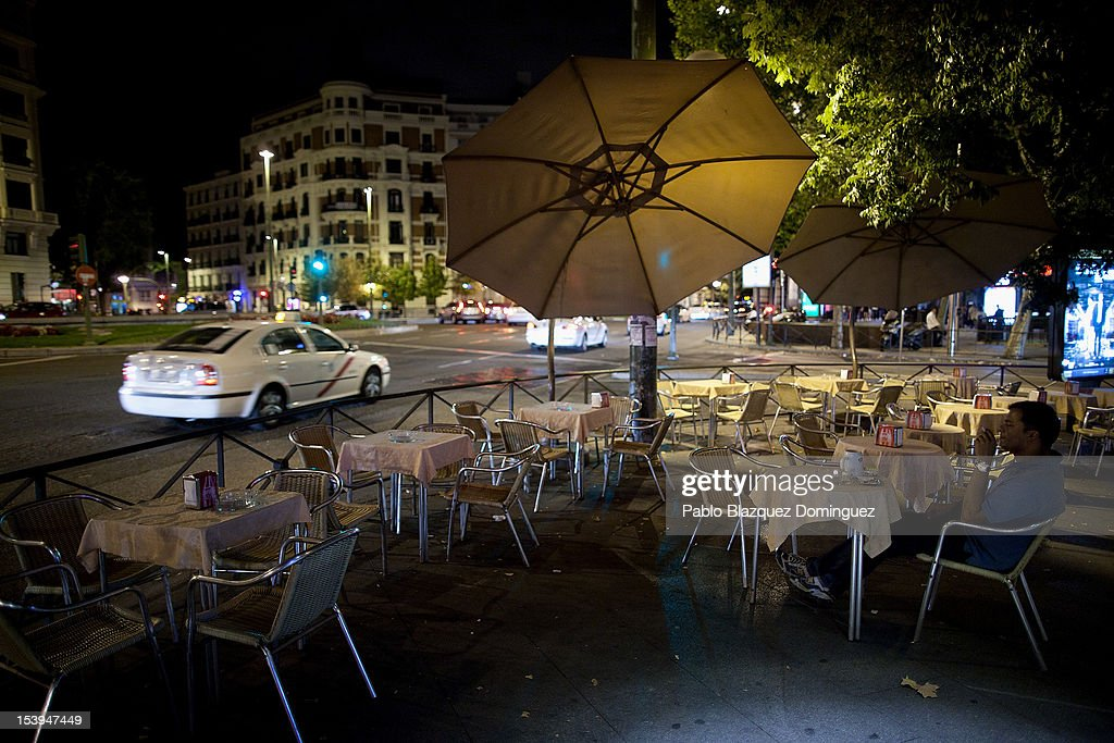 A man sits at an empty cafe terrace on October 11, 2012 in Madrid, Spain. Ratings agency Standard & Poor's has cut Spain's credit rating down to BBB-. The Spanish government has already introduced both spending cuts and tax rises in an attempt to ease their debt and reduce their high unemployment levels. Spanish Economy Minister Luis de Guindos maintains that his country will not need to ask for a bailout.