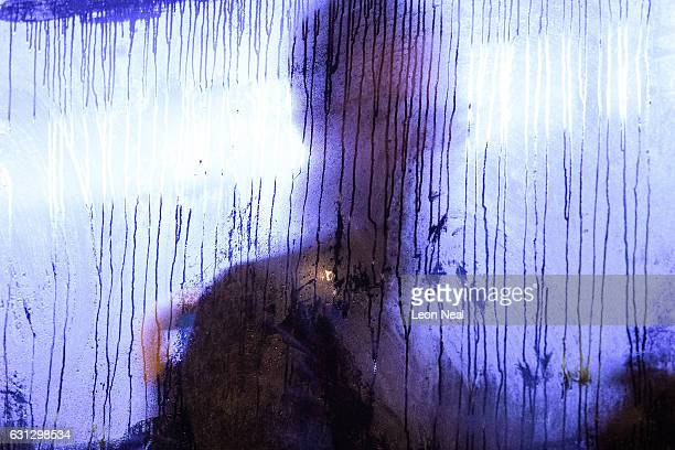 A man sits behind a steamed up window on a crowded bus on London Bridge as a planned tube strike on the London underground network takes place on...