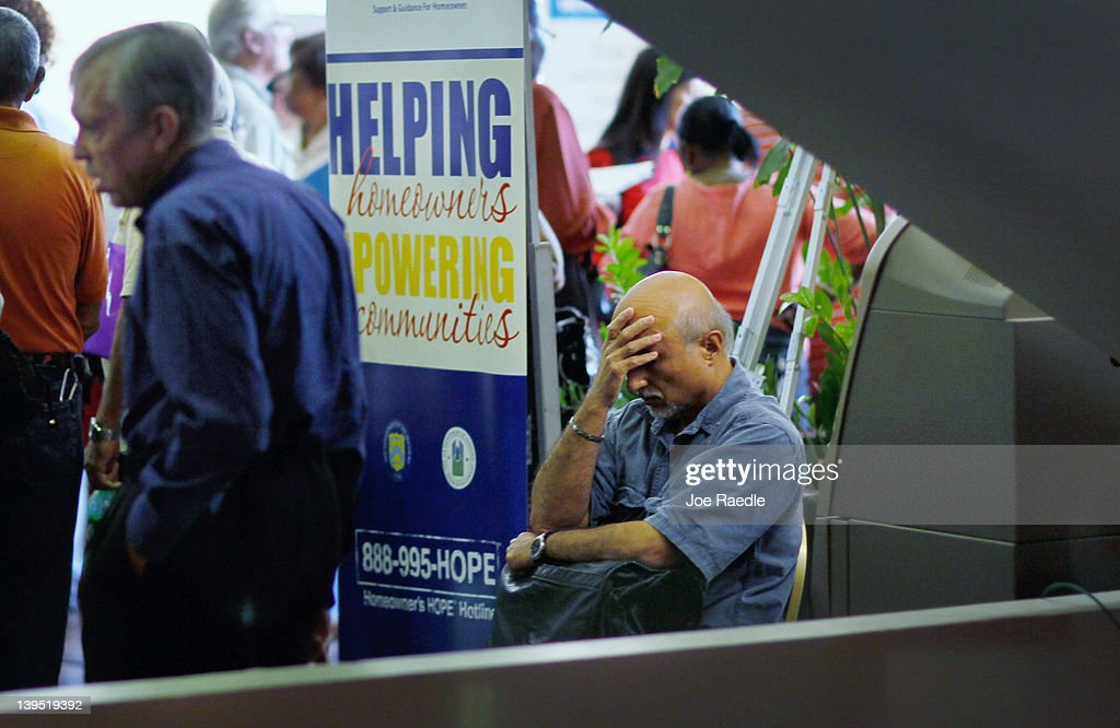 A man sits during a Help for Homeowners Community Event at the James L. Knight Center on February 22, 2012 in Miami, Florida. The event put on by the U.S. Treasury Department along with the U.S. Department of Housing and Urban Development and Hope Now is for homeowners who have fallen behind on their mortgages or who are facing financial difficulty and at risk of falling behind.