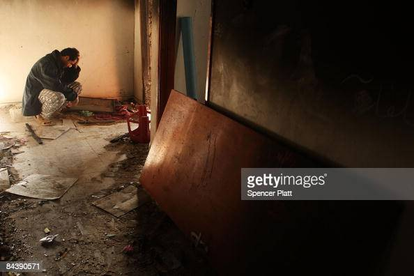 A man sits in his destroyed home January 21 2009 in a suburb of Gaza City Gaza Strip Over 70 percent of Gaza is still without power with chronic food...