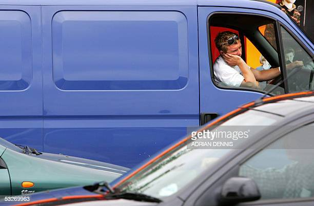 A man sits in his van during a traffic gridlock near Vauxhall Cross in London 22 July 2005 The area was plunged into chaos after emergency services...