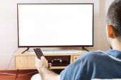 Man sits in sofa watching tv