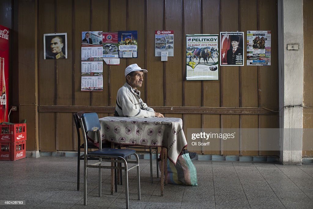 A man sits in the bus station cafe in the town of Soma whose economy relies heavily on the mining industry on May 20 2014 in Soma Turkey Three...