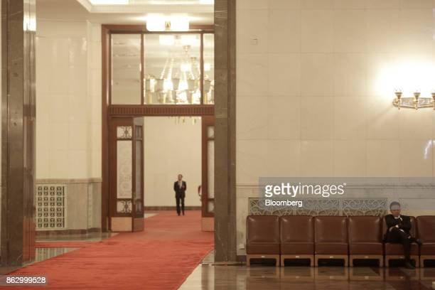 A man sits in the Great Hall of the People during the 19th National Congress of the Communist Party of China in Beijing China on Thursday Oct 19 2017...