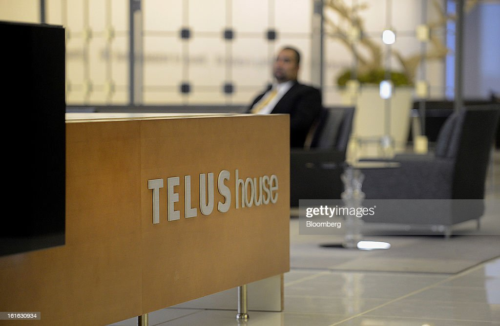 A man sits in the lobby of the Telus Corp. office in Toronto, Ontario, Canada, on Wednesday, Feb. 13, 2013. Telus Corp. is scheduled to release earnings data on Feb. 15. Photographer: Aaron Harris/Bloomberg via Getty Images