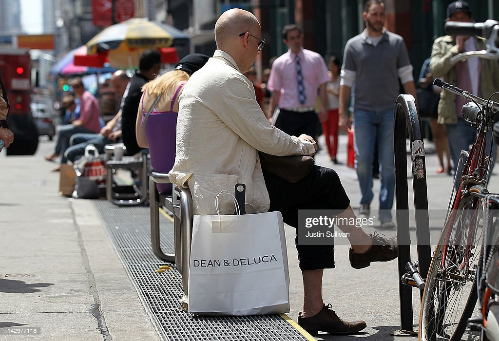 A man sits next to a Dean and Deluca shopping bag on Broadway on April 16, 2012 in New York City. Despite high energy prices, the Commerce Department reported today that retail sales beat expectations in March with an 0.8 percent rise compared to a 1.0 percent increase in February.