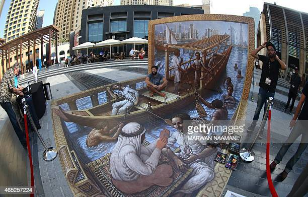 A man sits on a 3D artwork by US artist Kurt Wenner on March 4 2015 near the Jumeirah Beach Residence in Dubai during the Canvas Festival a...