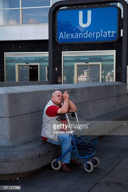 A man sits on a bench with a walker at the entrance to the subway station Alexanderplatz on September 1 2012 in Berlin Germany Berlin celebrates his...