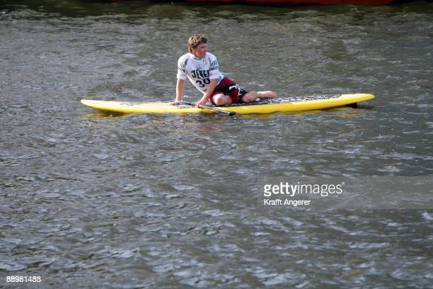 A man sits on his standup paddleboard during day one of the Jever SUP World Cup 2009 on July 10 2009 in Hamburg Germany