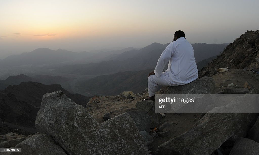 A man sits on the side of a hill waiting to see the new moon of Ramadan as astronomers and scholars of Islam debate when the holy Muslim month of Ramadan begins, in the Saudi city of Taif on July 19, 2012. The start of the fasting month, when the faithful abstain from eating from dawn to sunset, is determined by the sighting of the new moon.