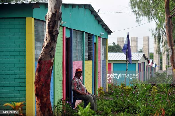 A man sits outside of his house in the neighborhood of Casas de Nemagon Managua on August 7 2012 AFP PHOTO/Hector RETAMAL