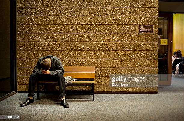 A man sits outside the courtroom of Carla AlessioPolicandriotes a circuit judge with the Illinois Twelfth Circuit prior to a session of drug court at...