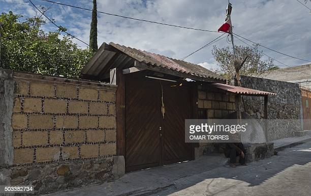 A man sits outside the house of Gisela Mota the mayor who was gunned down a day after taking office in Temixco Morelos State Mexico on January 4 2016...