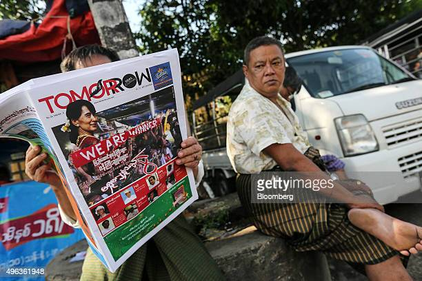 A man sits reading a Tomorrow News Journal newspaper at a bus stop in Yangon Myanmar on Monday Nov 9 2015 Myanmar opposition leader Aung San Suu Kyi...