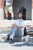 A man sits while police search his car after they found a meat cleaver in it in front of John Joseph Moakley United States Courthouse during the...