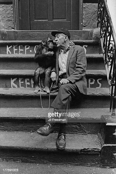 A man sits with a pet chimpanzee on steps in MacDougal Street Greenwich Village New York City 1972