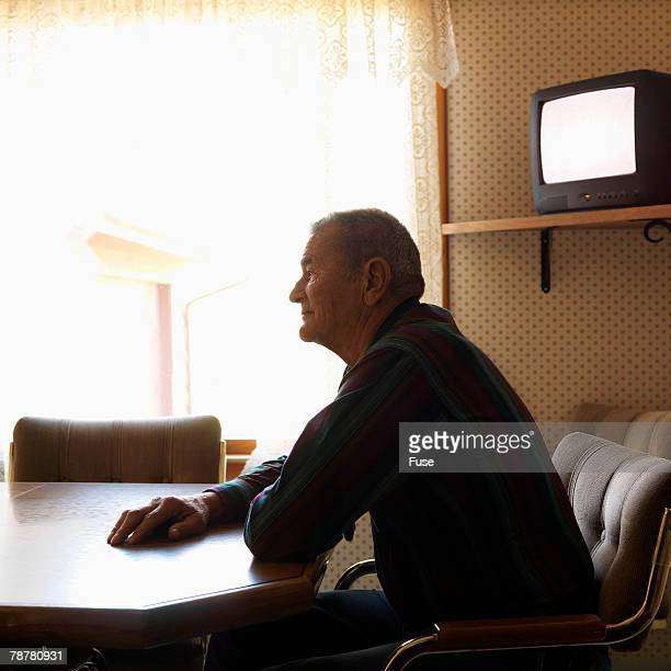 Man Sitting Alone at a Table
