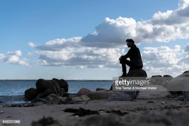 Man sitting alone at the beach