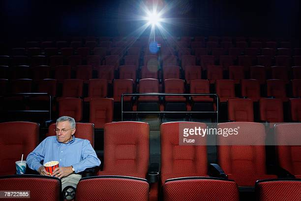 Man Sitting Alone in Theatre