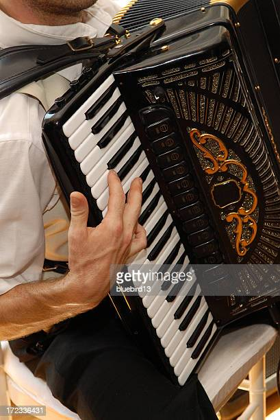 Man sitting and playing vintage accordion