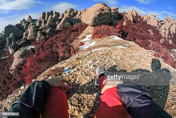 Man sitting and staring the Montserrat landscape.