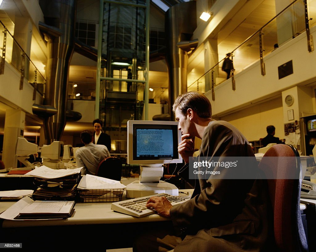Man sitting at desk in office : Stock Photo
