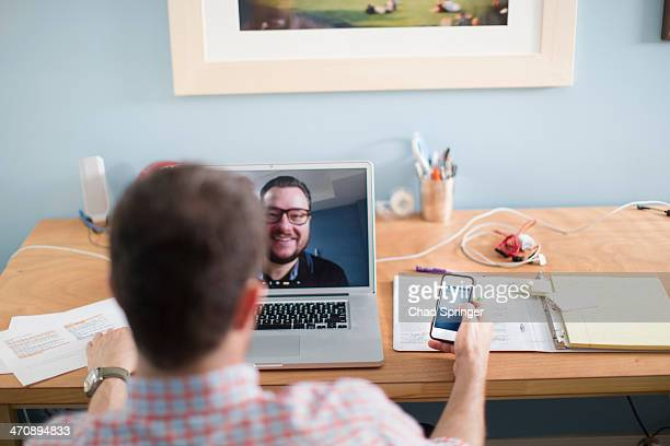 Man sitting at desk making video call