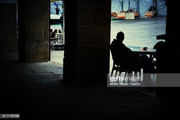Man sitting at outdoor cafe