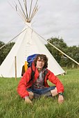 Man sitting by teepee
