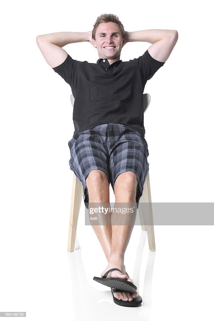 Man sitting in a chair and smiling
