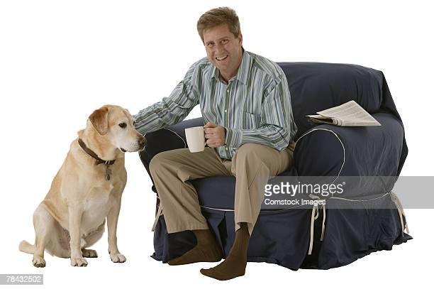 Man sitting in a recliner near his dog