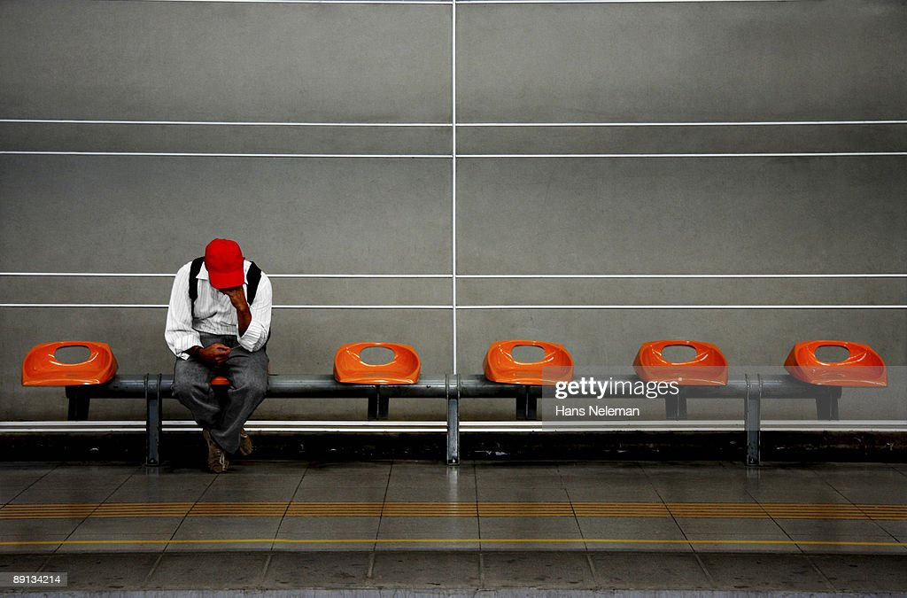 Man sitting in a subway, Santiago, Chile