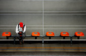 Man sitting in a subway, Santiago, Chile
