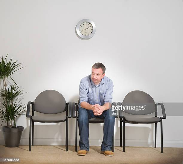 Man Sitting in a Waiting Room