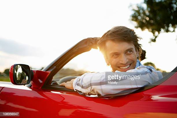 Man sitting in an electric sports car
