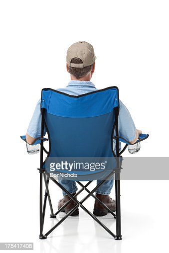 Man Sitting in an Outdoor Folding Chair