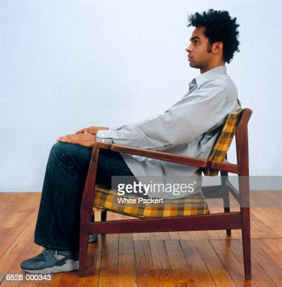 Man sitting in armchair stock photo getty images for Sitting in armchair
