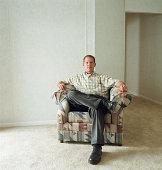 Man sitting in armchair, portrait