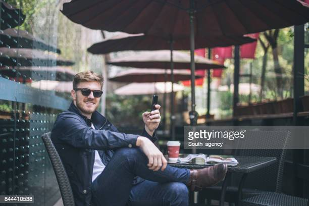 Man sitting in cafe alone