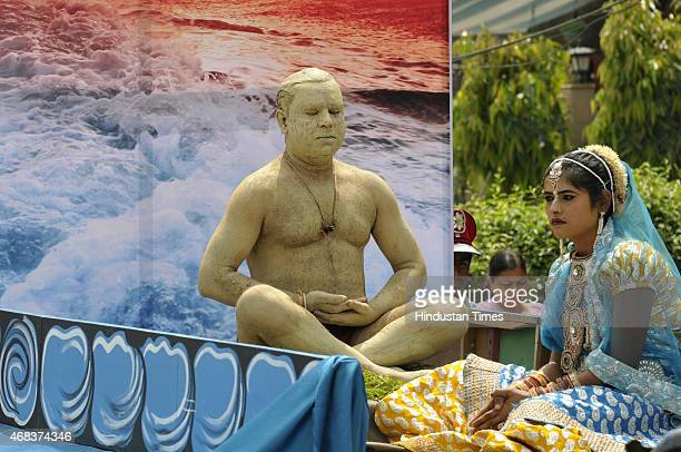 A man sitting in dhyan pose during a procession was organised by Jain community on the occasion of Mahavir Jayanti on April 2 2015 in Noida India It...