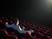 Man sitting in empty cinema