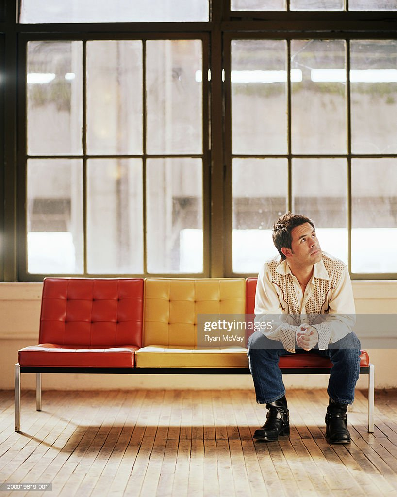 Man Sitting In Front Of Large Windows Stock Photo Getty