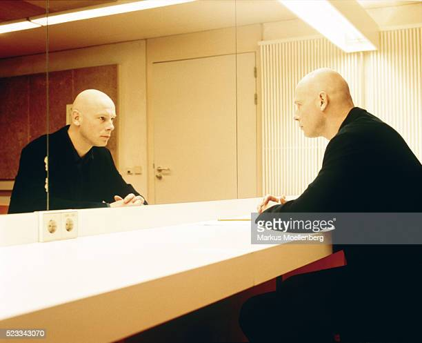 Man sitting in front of mirror