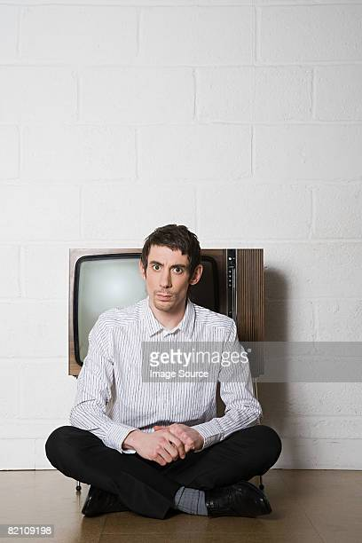 Man sitting in front of television